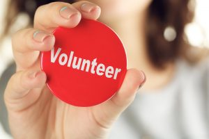 Round volunteer button