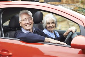 senior couple driving